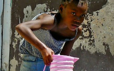 Young Haitian Girl Filling Water