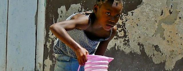 Young Haitian Girl Filling Water